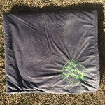 Gray blanket with LIFE logo stitched into it
